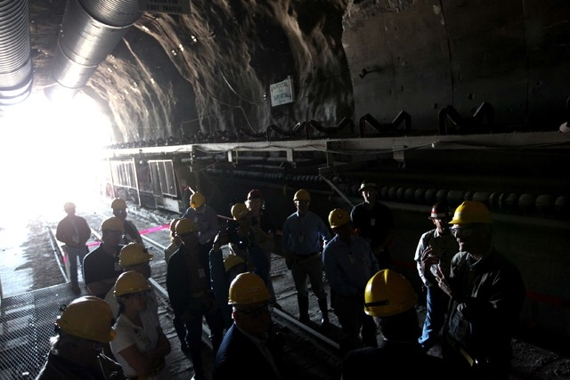 Members of the U.S. House Energy and Commerce Subcommittee on Environment and Economy are accompanied by their staff as the take a tour of the Yucca Mountain nuclear waste repository on Tuesday, A ...