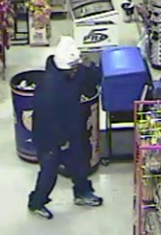 This image from a security camera shows a masked suspect during a robbery on Nov. 13 at a convenience store near Owens Avenue and Nellis Boulevard on Nov. 13. (Courtesy, LAS VEGAS METROPOLITAN POL ...