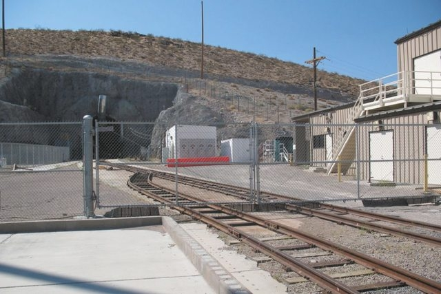 A fence surrounds the north entrance to the 5-mile tunnel that loops through Yucca Mountain, 100 miles northwest of Las Vegas. The Department of Energy closed the exploratory tunnel earlier this y ...