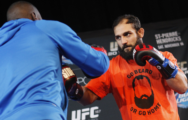 Johny Hendricks, right, works out for the media Wednesday ahead of his bout against welterweight champion Georges St. Pierre in the main event of UFC 167 on Saturday. (Jason Bean /Las Vegas Review ...