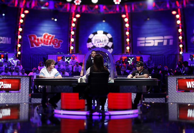 Ryan Riess, left, and Jay Farber face off on the final night of the World Series of Poker at the Rio in Las Vegas Tuesday, Nov. 5, 2013. (John Locher/Las Vegas Review-Journal)