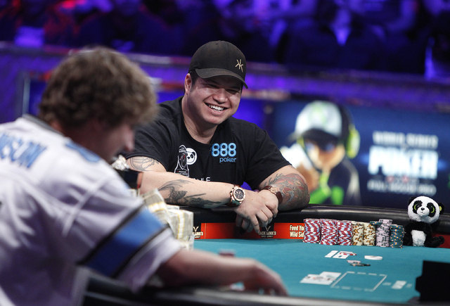 Jay Farber, right, and Ryan Riess face off on the final night of the World Series of Poker at the Rio in Las Vegas Tuesday, Nov. 5, 2013. (John Locher/Las Vegas Review-Journal)