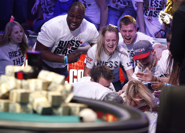 Friends and family of Ryan Riess celebrate after he won the World Series of Poker at the Rio in Las Vegas Tuesday, Nov. 5, 2013. (John Locher/Las Vegas Review-Journal)