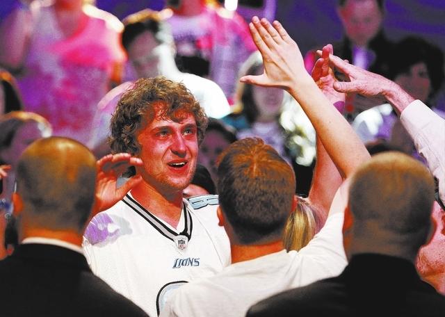 Ryan Riess celebrates after winning the World Series of Poker at the Rio in Las Vegas Tuesday, Nov. 5, 2013. (John Locher/Las Vegas Review-Journal)