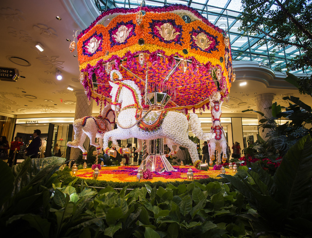 A  floral carousel as seen Monday, Nov. 25, 2013 in the atrium at Wynn Las Vegas . The carousel and a hot air balloon installations contain more the 110,000 flowers.  (Jeff Scheid/Las Vegas Review ...