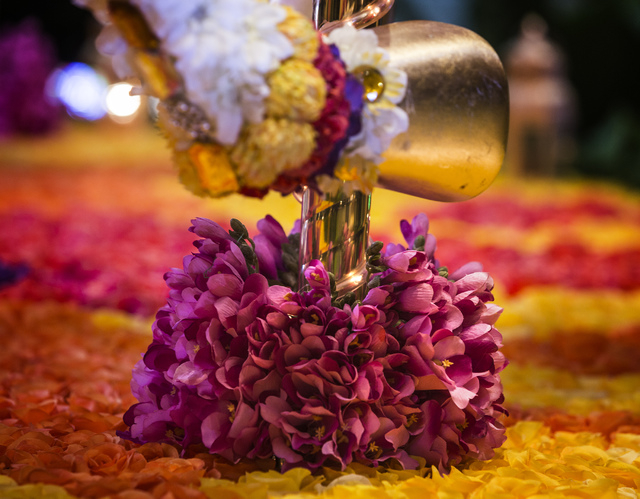 A  floral carousel as seen Monday, Nov. 25, 2013 in the atrium at Wynn Las Vegas . The carousel and a hot air balloon sculptures contain more the 110,000 flowers.  (Jeff Scheid/Las Vegas Review-Jo ...
