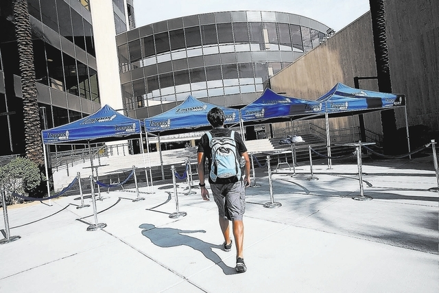 Zappos developer Norbinn (cq) Rodrigo enters the new Zappos campus Monday, Sep. 9, 2013. Rodrigo is among the first wave of employees to work at the new campus. (Jessica Ebelhar/Las Vegas Review-J ...