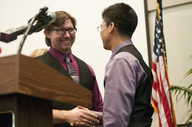 Student Josue Mendoza-Garcia, right, congratulates his teacher, Nevada Teacher of the Year Jeffrey A. Hinton during a ceremony honoring him at Northwest Career and Technical Academy in Las Vegas W ...