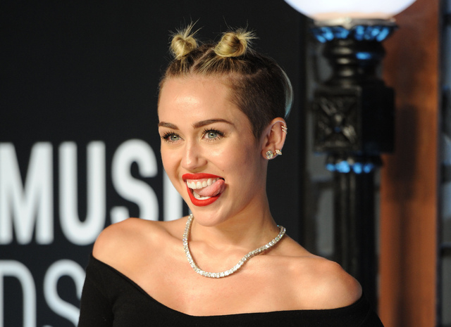 Singer Miley Cyrus was No. 1 on Google's list of most-searched people. She also was No. 1 on Yahoo's search rankings. (Photo by Evan Agostini/Invision/AP, File)