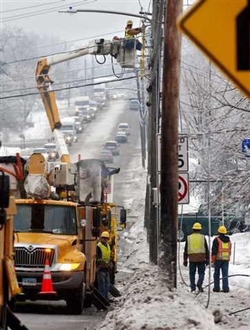 Utility crews respond to a downed power line at the intersection of Dorset Street and Kennedy Drive in South Burlington, Vt., on Monday, Dec. 23, 2013. From Michigan to Maine, hundreds of thousand ...