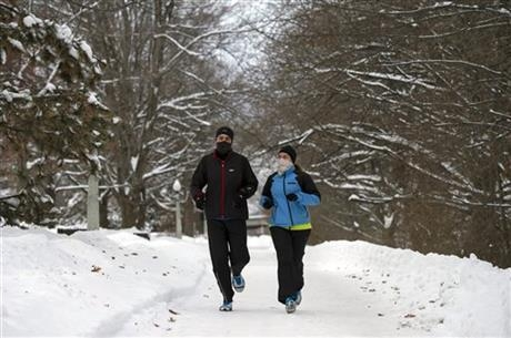 Joggers go for a Christmas day run near the Rideau Canal in Ottawa, Canada on Wednesday, Dec. 25, 2013. (AP Photo/The Canadian Press, Justin Tang)