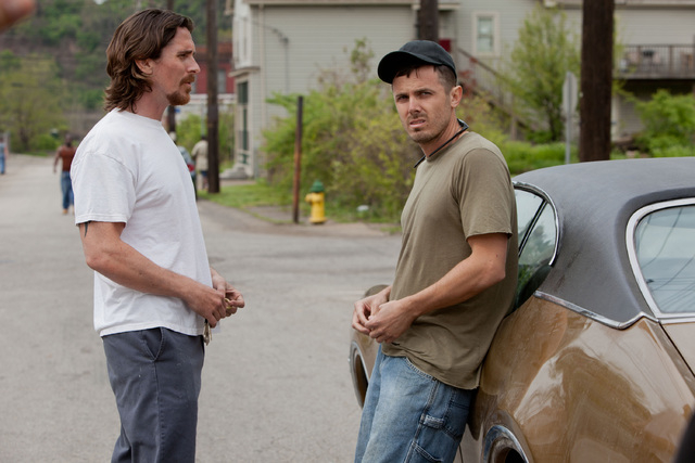 """This image released by Relativity Media shows Christian Bale, left, and Casey Affleck  in a scene from """"Out of the Furnace."""" (AP Photo/Relativity Media, Kerry Hayes)"""