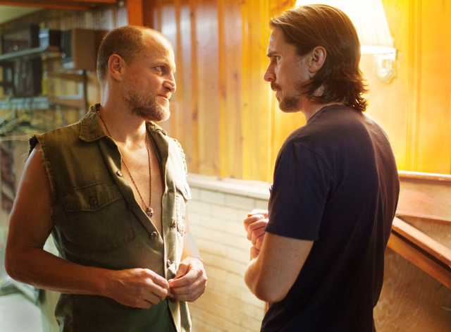 """This image released by Relativity Media shows Woody Harrelson, left, and Christian Bale in a scene from """"Out of the Furnace."""" (AP Photo/Relativity Media, Kerry Hayes)"""