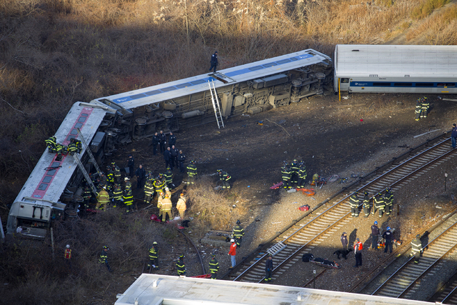"""First responders gather at the derailment of a Metro North passenger train in the Bronx borough of New York Dec. 1, 2013  The Fire Department of New York says there are """"multiple injuries&quo ..."""