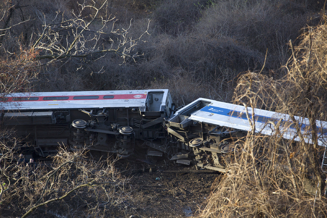 """Passenger cars are on their side after a Metro-North train derailed in the Bronx on Sunday morning, Dec. 1, 2013 causing """"multiple injuries,"""" authorities said. Metropolitan Transportatio ..."""