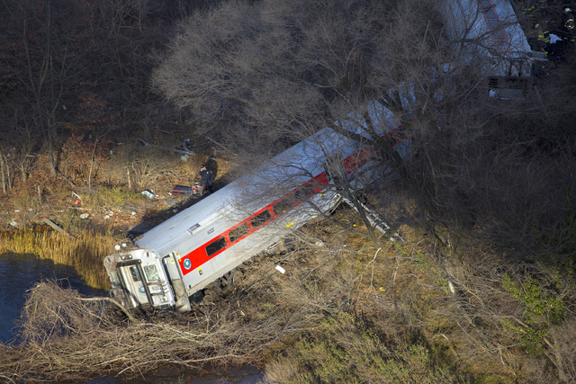 """First responders gather around the derailment of a Metro North passenger train in the Bronx borough of New York Dec. 1, 2013  The Fire Department of New York says there are """"multiple injuries ..."""