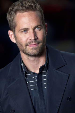 File-This March 21, 2013 file photo shows actor Paul Walker wearing a creation from the Colcci summer collection at Sao Paulo Fashion Week in Sao Paulo, Brazil.  A publicist for actor Walker says  ...