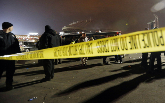 Kansas City, Mo. police work a crime scene in parking lot A outside Arrowhead Stadium, in Kansas City, Mo., after a person was killed Sunday, Dec. 1, 2013. Police Chief Darryl Forte said the death ...