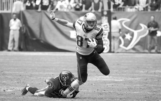 New England Patriots tight end Rob Gronkowski (87) runs during the fourth quarter of an NFL football game against the Houston Texans Sunday, Dec. 1, 2013, in Houston. (AP Photo/David J. Phillip)