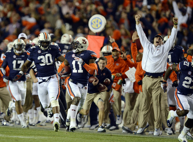 Auburn cornerback Chris Davis (11) returns a missed field-goal attempt more than 100 yards for a touchdown on the final play of an NCAA college football game against Alabama in Auburn, Ala., Satur ...