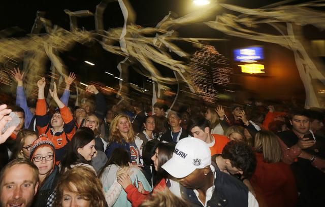 Auburn fans roll Toomer's Corner following their 34-28 win over No. 1 Alabama in an NCAA college football game in Auburn, Ala., Saturday, Nov. 30, 2013.  (AP Photo/Jay Sailors)