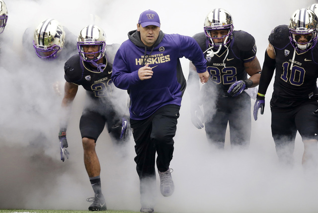 FILE - In this Nov. 29, 2013 file photo, Washington head coach Steve Sarkisian runs onto the field before NCAA college football game against Washington State in Seattle. Sarkisian has accepted the ...