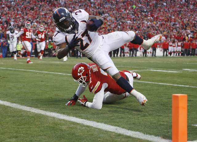 Denver Broncos running back Knowshon Moreno (27) dives into the end zone for a touchdown against Kansas City Chiefs cornerback Sean Smith (27) during the first half on Sunday in Kansas City, Mo. ( ...