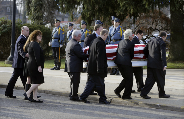 The flag-draped casket is carried into the church during the funeral for Michael Feeney Tuesday, Dec. 3, 2013, in Ridgewood, N.J. Feeney, 10, was named Ridgewood's honorary police chief for 2013 b ...