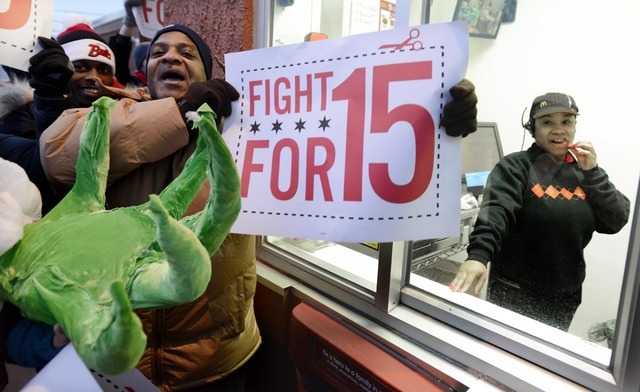 Protesters protest for higher wages outside a McDonalds restaurant in Chicago, Thursday, Dec., 5, 2013. Demonstrations planned in 100 cities are part of a push by labor unions, worker advocacy gro ...