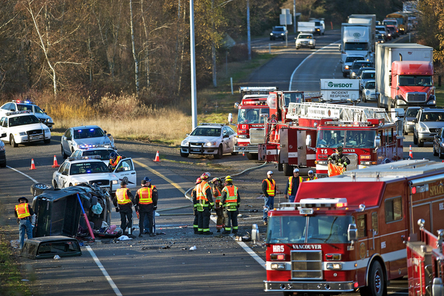 In this Dec. 4, 2013 photo, crews respond to an accident in Vancouver, Wash. Caran Johnson who regularly monitors police scanner traffic unknowingly live-tweeted about her husband's death in the f ...