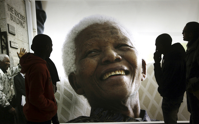 Giant photographs of former South African President Nelson Mandela are displayed June 27 at the Nelson Mandela Legacy Exhibition at the Civic Centre in Cape Town, South Africa. (AP Photo/File)