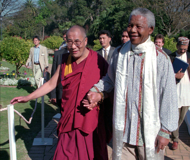 The Dalai Lama, left, walks hand-in-hand with South African President Nelson Mandela prior to an official reception at the presidential office in Cape Town, South Africa, on Aug. 22, 1996. South A ...