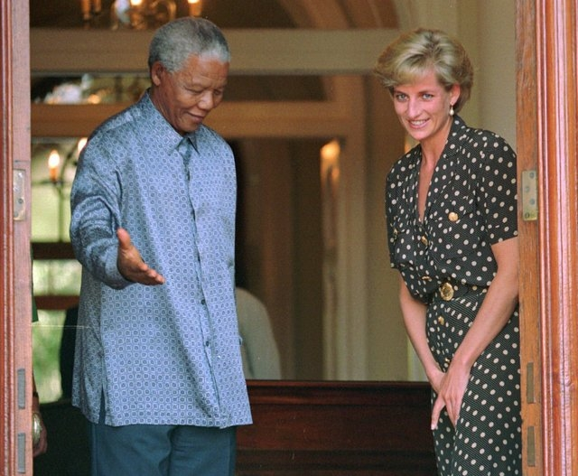 South African President Nelson Mandela shows the way to Britain's Princess Diana in Cape Town, South Africa, on March 17, 1997, where they discussed the threat of AIDS in the country. South Africa ...
