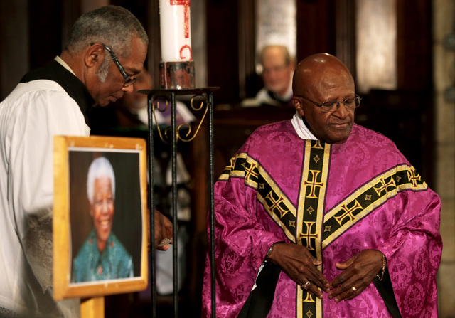 Archbishop Emeritus Desmond Tutu, right, leads a prayer service in memory of former South African president Nelson Mandela, at St George's Cathedral in Cape Town, South Africa on Friday. Mandela p ...