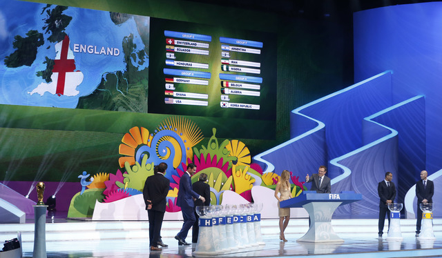 England's ticket is drawn during the draw ceremony for the 2014 soccer World Cup in Costa do Sauipe near Salvador, Brazil, Friday, Dec. 6, 2013. (AP Photo/Victor R. Caivano)