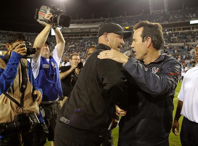 Jacksonville Jaguars head coach Gus Bradley, left, shakes hands with Houston Texans head coach Gary Kubiak, right, after an NFL football game, Thursday, Dec. 5, 2013, in Jacksonville, Fla. Jackson ...