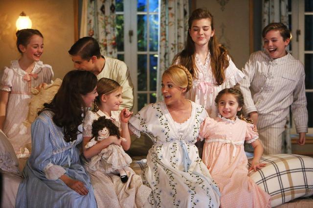 This photo provided by NBC shows, from left, Sophia Ann Caruso as Brigitta, Ariane Rinehart as Liesl, Michael Nigro as Friedrich, Grace Rundhaug as Marta, Carrie Underwood as Maria, Ella Watts-Gor ...