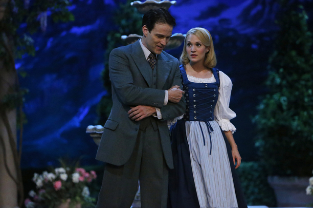 """This photo provided by NBC shows Stephen Moyer, left, as Captain Von Trapp and Carrie Underwood as Maria, in """"The Sound of Music Live!"""" airing Thursday, December 5, 2013, on NBC (8-11 p. ..."""