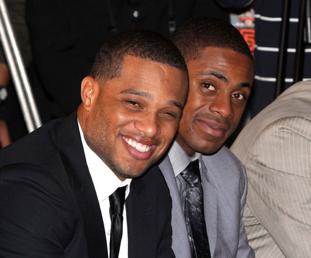In this Oct. 30, 2011 file photo, Robinson Cano of the New York Yankees, left, and teammate Curtis Granderson smile during a press conference for a baseball series in Taipei, Taiwan. The Seattle M ...