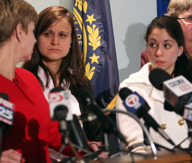Zenya Hernandez, center, and her daughter, Sarah Hernandez look at Senior Assistant Attorney General Jane Young, during a news conference Friday Dec. 6, 2013 in Concord, N.H. Young said missing te ...