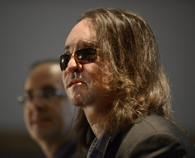 The nation's first full face transplant patient Dallas Wiens looks on during a news conference at McCormick Place in Chicago, Wednesday, Dec. 4, 2013. Medical imaging shows new blood vessel networ ...