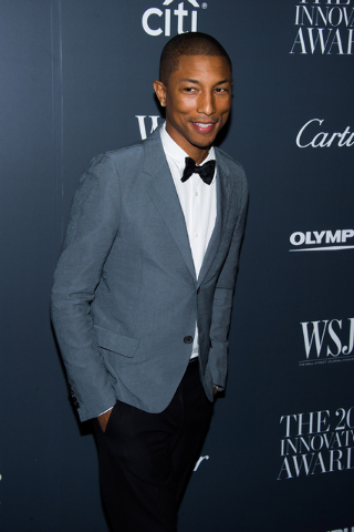In this Nov. 6, 2013 file photo, Pharrell Williams attends the WSJ. Magazine's Innovator Awards in New York. Williams was among the top nominees for the 56th annual Grammy Awards announced Friday  ...