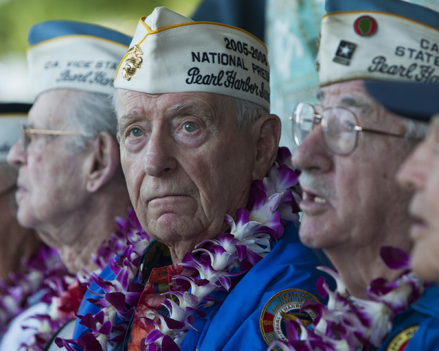 Pearl Harbor survivor Mal Middlesworth, center, sits with other Pearl Harbor survivors before the start of ceremony commemorating the 72nd anniversary of the attack on Pearl Harbor, Saturday, Dec. ...