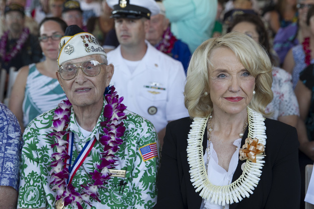 Pearl Harbor survivor Sterling Cale, left, and Arizona Gov. Jan Brewer wait for the start of ceremony commemorating the 72nd anniversary of the attack on Pearl Harbor, Saturday, Dec. 7, 2013, in H ...