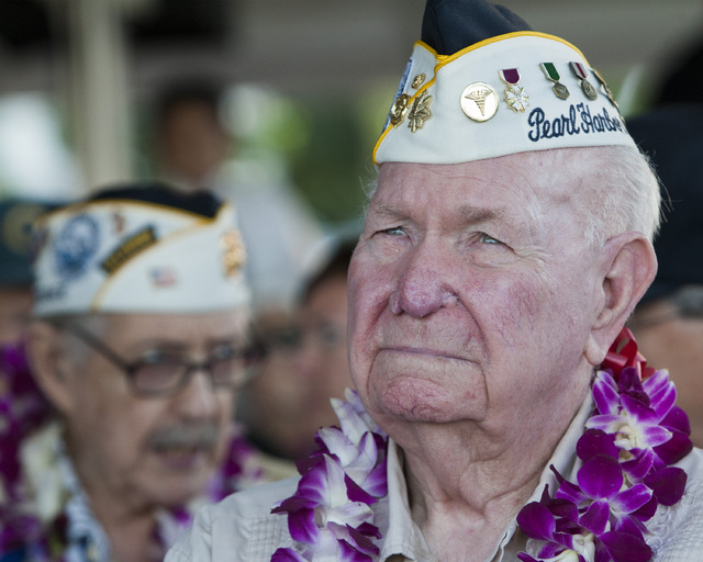Pearl Harbor survivor Alvis Taylor waits for the start of the ceremony commemorating the 72nd anniversary of the attack on Pearl Harbor in Honolulu on Saturday, Dec. 7, 2013. (AP Photo/Marco Garcia)