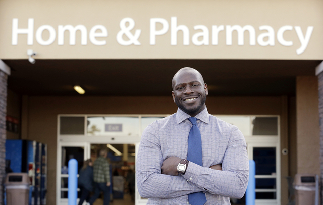 James Lott outside the Wal-Mart store where he works as a pharmacist in Bonney Lake, Wash., in this Nov. 19 photo. Lott, who lives in Renton, Wash., a suburb of Seattle, adds significantly to his  ...