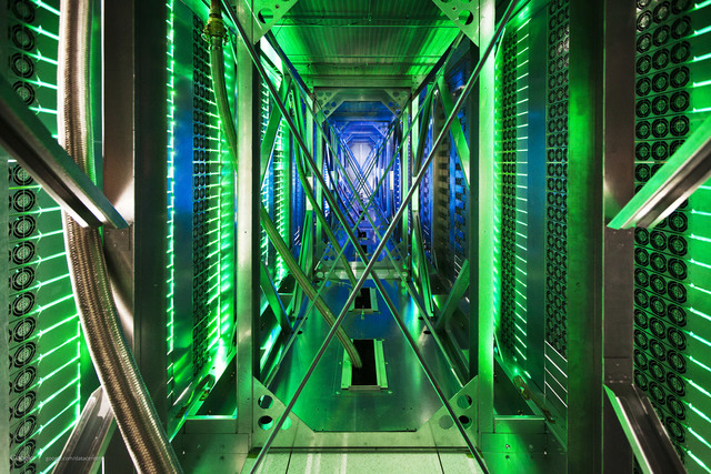 In this undated file photo made available by Google, hundreds of fans funnel hot air from the computer servers into a cooling unit to be recirculated at a Google data center in Mayes County, Okla. ...