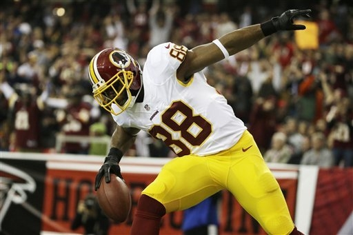Washington Redskins wide receiver Santana Moss (89) celebrates his touchdown against the Atlanta Falcons during the first half of an NFL football game, Sunday, Dec. 15, 2013, in Atlanta. (AP Photo ...