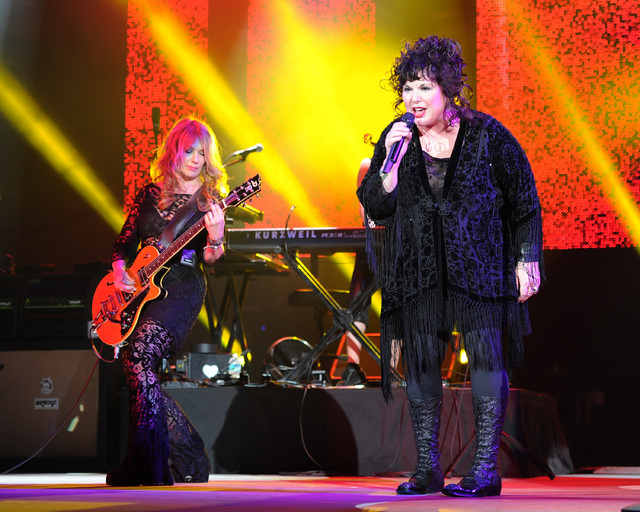 This June 17, 2013 file photo shows Nancy  Wilson, left, and Ann Wilson of Heart performing on opening night of the Heartbreaker Tour at the Cruzan Amphitheater in West Palm Beach, Fla. The group  ...
