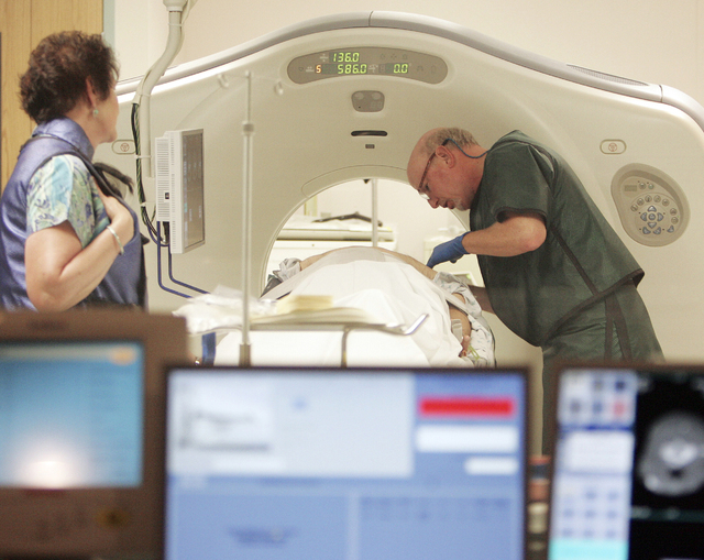 In this 2010, file photo, Dr. Steven Birnbaum works with a patient in a CT scanner at Southern New Hampshire Medical Center in Nashua, N.H. A national study suggests the world's top cancer killer  ...
